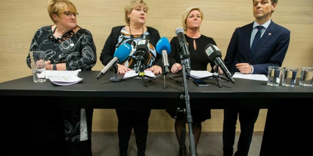 """— Et budsjett for høyere utdanning, sier Trine Skei Grande. Her sammen med Erna Solberg, Siv Jensen og Knut Arild Hareide på en pressekonferanse lørdag kveld. Foto: <span class=""""caps"""">NTB</span>Scanpix"""