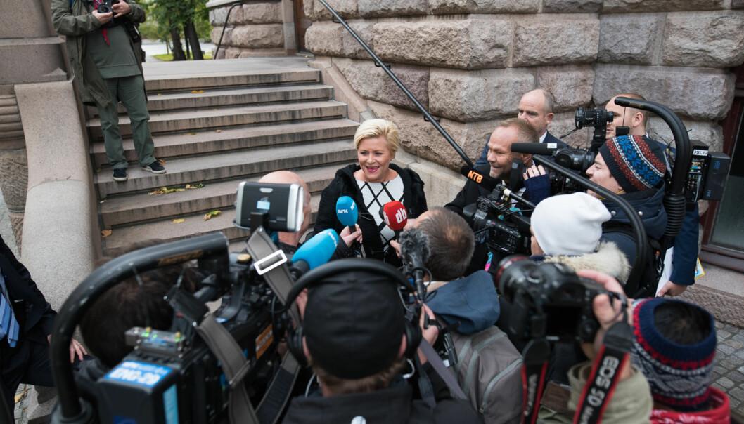 Finansminister Siv Jensen på vei inn på stortinget for å presentere årets stasbudsjett. Finanstalen startet10.00. Foto: Skjalg Bøhmer Vold