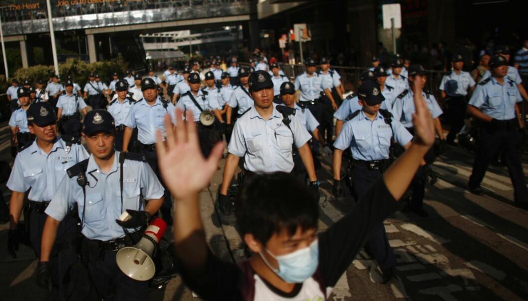 Studentføderasjonen i Hongkong har fått frist til mandag med å avslutte demonstrasjonene. FOTO: NTBscanpix