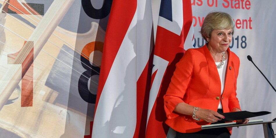 Theresa May har så langt ikkje klart å få til ei mjuk utmelding frå EU. Fredag kan det vere over, med ein hard utgang. Norske forskarar håper på løysing. Foto: NTB Scanpix/Christof Stache